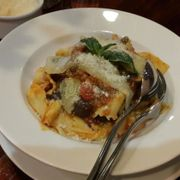 Papardelle with carpes, peronico cheese and tomato sauce