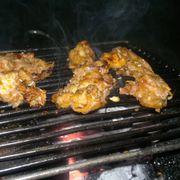 thịt thỏ đang nướng
