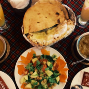 Roti, cheese nan, beef and chicken curry, chicpea salad