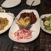 From left: seafood pasta, cajun pork and green salad