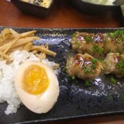 Omakase last plate. Pork belly wrapped ramen with house menma and onions, soy egg.