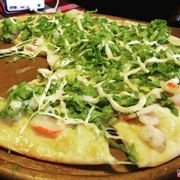Seafood Caesar Pizza. Very very delicious, it tastes like the Regular Seafood Pizza but better! With added flavor and lettuce.