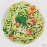 Fetucini pesto sauce with tomato and chicken