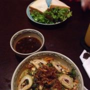 Vegetables with rice noodles and a tuna sandwich